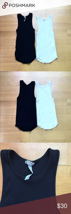 NWOT fp tank bundle One black, one white cotton ribbed tank tops from free people intimately. Size xs/s and could fit either 😊 Free People Tops Tank Tops