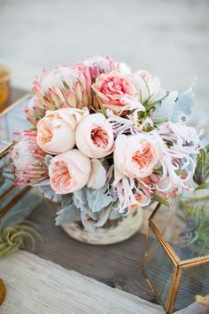 peony and protea centerpiece