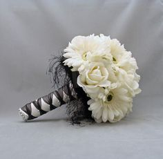 Cute silk flower gerber daisy and rose wedding bouquet. I think white bouquets for the bridesmaids and a pink bouquet for me