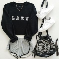 "- Description - Size Guide Details: 'Lazy' cropped oversized crew neck fleece black sweatshirt by NYCT Clothing. Unisex fit. 50% Cotton, 50% Polyester. Made in USA. Sizing: 40""/101.6 cm width 17.5""/44"