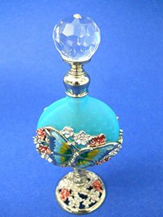 Butterfly Perfume Bottle Glass Turquoise Blue Clear Faceted Stopper Pink Flower Wellforth http://www.amazon.com/dp/B00TVM1FDO/ref=cm_sw_r_pi_dp_vPt6ub17Y0MZG