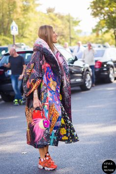 abstract print coat with funky sneakers
