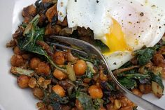 Curried Chick Peas & Chard with Poached Eggs skilleted a can of chick peas in hot oil and garlic, much the same way I do roasted chick peas with chard, but quicker, and with a dab of curry paste. I tore in a few sad chard leaves, then topped it with a poached egg, as W had required poached eggs on toast for dinner. http://dinnerwithjulie.com/2010/02/27/curried-chick-peas-chard-poached-eggs/