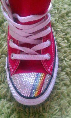 fadb287dc006 Adults red converse with genuine swarovski crystals in clear with a rainbow  stripe
