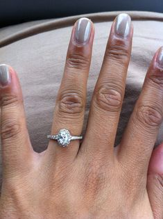 oval engagement ring with halo-- this is just gorgeous. The oval cut gives it a really romantic feel. Small Engagement Rings, Oval Halo Engagement Ring, Engagement Bands, Bridal Rings, Wedding Rings, Dream Ring, Trendy Wedding, Dream Wedding, Wedding Ideas