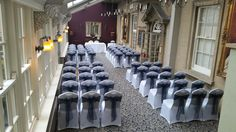 Navy blue organza sashes on white covers at The Manor Hotel