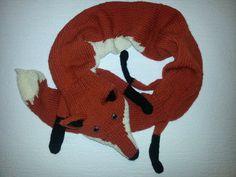 Hand-knitted reddish orange fox scarf. via Etsy.