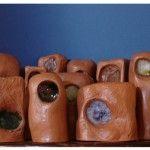 Cíclopes - Serie de 14 piezas - Escultura, barro cocido, vidrio fundido - Pilar Barrios.