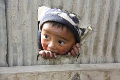 An inquisitive young resident of Lo Manthang...click here to see this amazing photo and account of Mollie Fitzgerald's Journey through Nepal | Frontiers Travel