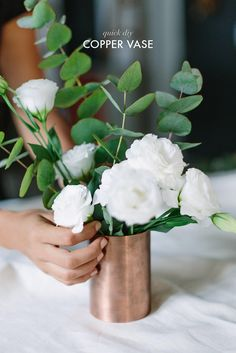 simple white flower arrangement in a copper vase. modern centerpiece for a budget wedding. learn how to DIY this vase. Fake Flower Arrangements, Fake Flowers, Flower Vases, White Flowers, Diy Flowers, Flowers In A Vase, Flower Wall, New Shape, Diy Home Decor Rustic