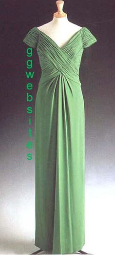 Designed by Catherine Walker, this emerald green silk-georgette gown was worn by Diana on several occasions. In 1992 she wore this dress with emerald jewelry to an 80th birthday party for orchestra conductor, Sir George Solti at Buckingham Palace. She wore it to London's Dorchester Hotel on November 11, 1993 for her last state banquet hosted by the Malaysian government. Diana accessorized with Queen Mary's emerald necklace and the Spencer tiara. Lot #42 raised $ 24,150 for Diana's charities.