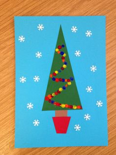 Christmas card craft idea for pre schoolers or young children. Finger print lights onto green triangle and decorate with snowflakes made with a paper cutter. Easy peasy.