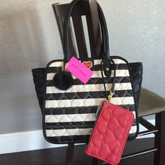 """Betsey Johnson bag Beautiful big Betsey Johnson tote bag!  Iconic black and white stripe with waffle heart pattern.   Roomy inside with snap closure and 2 open pockets and 1 zipper pocket.  Handle drop is 9"""".  Comes with a bonus zipper red wristlet.  Amazing brand new bag with tag attached. Betsey Johnson Bags Totes"""