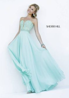 SHERRI HILL Prom Dresses 2015 # 32180 Embroidered lace sparkles with allover crystal bead work on a deep sweetheart neckline while a band of pearls cinch the waist. Soft flowing chiffon skirt is both sweet and romantic.