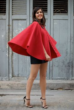 DIY studded red cape. add a hood and a basket filled with cupcakes. ask your sweetheart to dress up like a wolf. voila! cute halloween costume!