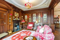 This impressive room boasts a whole host of fine period features with a delightful bay window enjoying wonderful Lake District scenery, window seat and panelling to every wall. A cast iron fireplace with oak surround is further complemented by impressive reproduction Victorian iron radiators.  Fine & Country | 1 Above Beck, Grasmere