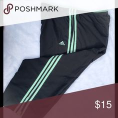 🥁Adidas Crop Pants Adidas Crop Pants.  Black is gray color with mint green stripes.  Side pockets, 100% Poly with mesh lining.  Worn one time!! Pants Ankle & Cropped