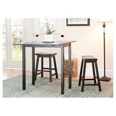 Add extra seating to your kitchen or breakfast nook with this stylish counter-height pub set, which includes a table and two stools crafted from sturdy Malaysian oak wood. The table is designed with two folding sides for easy storage. Small Kitchen Tables, Kitchen Dining Sets, Dining Room Bar, Dining Rooms, Small Dining, Dining Area, Kitchen Nook, Kitchen Seating, Space Kitchen