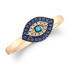 Love the turquoise at the center of this evil eye ring.