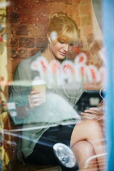 Businesswoman reading her digital tablet in a cafe