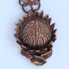 King protea pendant in bronze with copper chain King Protea, Cape Town South Africa, Handcrafted Jewelry, Handmade, Creative People, Jewelry Making, Bronze, Sculpture, Pendant