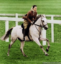 The queen going for a brisk gallop... I love how her hair is tied back in an Hermes scarf!