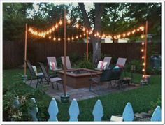 Set light poles in Fast-Setting #concrete, place around the perimeter of a fire pit and string with globe lights.