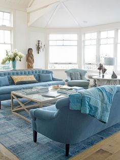 In the living area of this Martha's Vineyard home, furnishings are awash in a sea of blues.