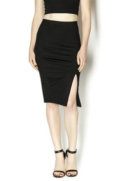Donna Mizani front slit midi skirt. Style with cropped tops and strappy heels on nights out.
