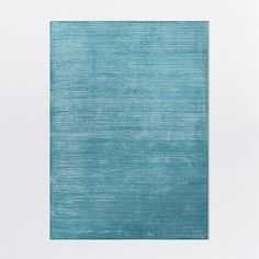Rug: We think your current rug could work in the space but we love this pop of colour.