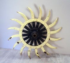vintage buckboard seats | Vintage rotary hoe wheel painted in a yellow and black sunflower ...