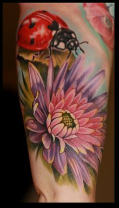 #tattoo ladybug flower