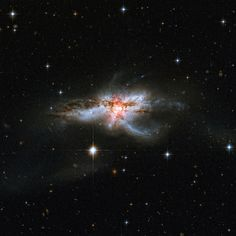 Tangled Galaxy | by sjrankin Edited Hubble image of the oddly shaped galaxy NGC 6240.