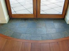The tile flooring inside this doorway looks awesome.