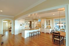 nice white kitchen with white appliances and warm woods