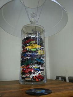 Love this car lamp idea.  Buy a vessel lamp and fill with any old toys for the kids.
