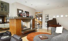 See-through fireplace, and fun mirror decor.