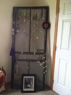 This is what I did with a very old screen door from an abandon house in Dorchester, Iowa.  Makes a great jewelry holder.  Slant it up against a wall.  Earrings go through the screen and I use push pins to hang necklaces.  ( I had permission to take the door)