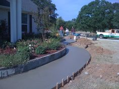 GroundScape, a Fort Worth Landscape Company, installed blue mist flowerbed edging around flower beds. GroundScape is currently installing a concrete sidewalk around the flowerbed that will lead to the driveway also being installed by GroundScape. Flower Bed Edging, Flower Beds, Drainage Solutions, Landscape Services, Landscaping Company, Sidewalks, Outdoor Living Areas, Walkways, Fort Worth