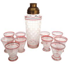 """An Art Deco hand painted glass cocktail shaker set with 10 glasses with a chequerboard pattern & brass lid.  Dimensions : Shaker - 9.5"""" H x 4"""" Dia Cup - 2.75"""" H x 2.5"""" Dia"""