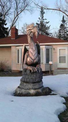 Carve old tree into a dragon