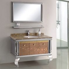 """This French designed contemporary vanity was crafted of exceptional quality, functionality and pure beauty. Standing on sleek """"S' shaped legs, this ornate vanity holds a single ceramic basin set into a stunning marble counter top complimented by a matching stainless steel shelf to house your toiletries. With its fitting mirror hanging atop, this vanity is sure to make your dream bathroom a reality. Luxury Bathroom Vanities, Mirror Hanging, Contemporary Vanity, Marble Countertops, Pure Beauty, Counter Top, Basin, Shelf, Stainless Steel"""