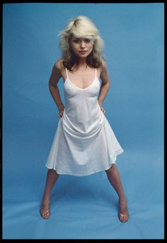 Debbie Harry has got an white silk dress with nipples cleavage