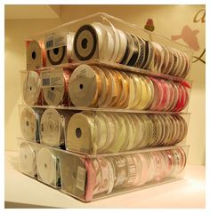 Check it out! Now EACH plastic bin stores about 60 spools of ribbon! Isn't that heavenly? This find was also at Target, in the closet section. It is called a 3 Compartment Drawer Organzier
