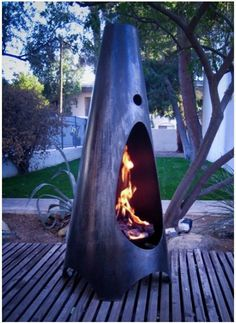 Backyard Firepit. Seems poor planning to have it sitting on a wood deck, though ... should sit on brick or cement slab