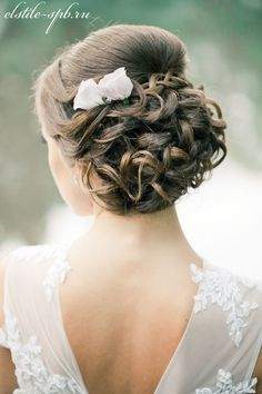 twisted updo bridal haistyles with flowers