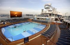 5. Take a Dip:  Naturally, you're sure to find plenty of people swimming around and sunning themselves at the main pool up on deck. It will be similar to the one aboard Quantum of the Seas (pictured).