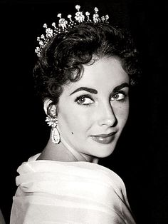 """Liz Taylor wearing the Mike Todd Tiara.  He gave it to her because it was """"fit for a queen"""".  This is circa 1957 at the Oscars where her 3rd husband producer Mike Todd had Around the World in 80 Days which  won for Best Picture"""