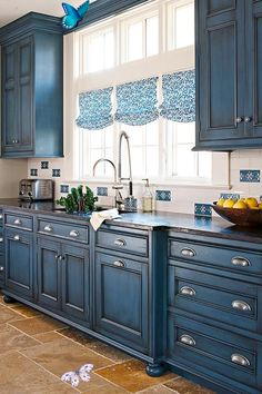 Kitchen Makeover: Small-Space Blue Kitchen Makeover This is a wonderful blue tone to use in cabin or sophisticated kitchens - Paint with Aubusson or Napoleonic Blue & add a Graphite Chalk Paint® wash + clear wax.<br> A homeowner makes big changes to a tiny space to get a modern kitchen perfect for hosting guests or just enjoying a morning coffee. Farmhouse Kitchen Cabinets, Kitchen Cabinet Design, Kitchen Paint, Best Kitchen Designs, Kitchen Ideas, Dining Room Design, Cool Kitchens, Small Spaces, Morning Coffee