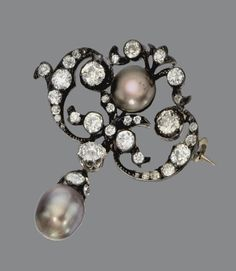 NATURAL PEARL AND DIAMOND BROOCH, CIRCA 1880.  The openwork cartouche set with old European-cut, old-mine and rose-cut diamonds centering a natural button pearl of natural black color measuring approximately 4.70 mm., supporting a natural black pearl pendant drop measuring approximately 9.7 by 8.0 mm., the total diamond weight approximately 1.80 carats, mounted in gold and silver, pendant detachable.